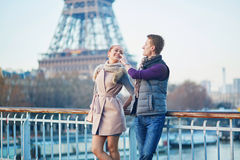Romantic couple near the Eiffel tower in Paris, France Royalty Free Stock Photography