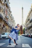 Romantic couple near the Eiffel tower in Paris stock photo