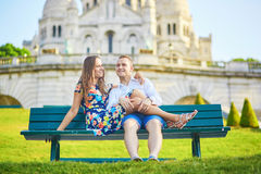 Romantic couple near Sacre-Coeur cathedral on Montmartre, Paris Royalty Free Stock Images