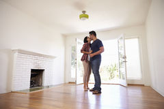 Romantic Couple In New Home On Moving Day Royalty Free Stock Images