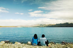 Romantic couple at New Zealand. A couple sitting in front of Lake at New Zealand Royalty Free Stock Photo