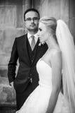 Romantic couple, newlywed valentynes posing near old baroque chu. Rch closeup b&w Stock Photo