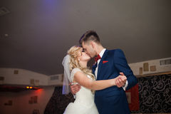 Romantic couple of newlyweds first elegant dance and kiss at wed Stock Images