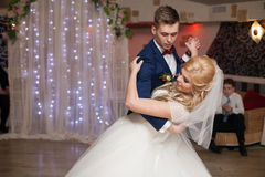 Romantic couple of newlyweds first elegant dance at wedding rece. Ption hall Royalty Free Stock Photos
