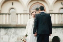 Free Romantic Couple Of Newlyweds Posing Near Old Church In Autumn Stock Photos - 66457303