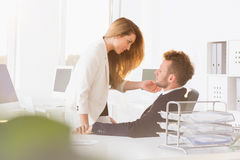 Romantic couple in the office. Shot of a romantic couple looking at each other seductively in the office Royalty Free Stock Image