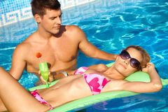 Romantic couple in outdoor pool Royalty Free Stock Photo