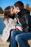 Romantic couple outdoors. Kissing in a park stock images