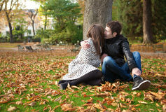 Romantic couple outdoors. At autumn, kissing royalty free stock photography