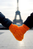Romantic couple in Paris. Male and female hands in a single glove for two stock image