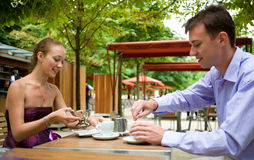 Romantic couple in Paris. Having breakfast in a Parisian street cafe Royalty Free Stock Images