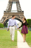 Romantic couple in Paris. Walking by the Eiffel Tower Stock Photography