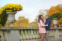Romantic couple in Paris on a fall day Royalty Free Stock Photo