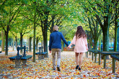 Romantic couple in Paris on a fall day Stock Photos
