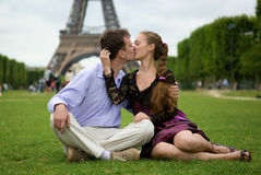 Romantic couple in Paris kissing. Near the Eiffel Tower Royalty Free Stock Photos