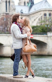 Romantic couple in Paris kissing Stock Images