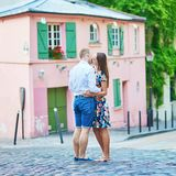 Romantic couple in Paris kissing each other on Montmartre. Romantic couple together in Paris kissing each other on Montmartre Royalty Free Stock Photos