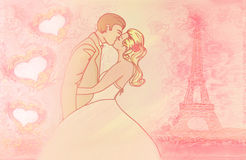 Romantic couple in Paris kissing near the Eiffel Tower. Royalty Free Stock Photos