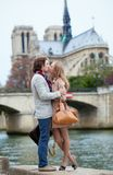 Romantic couple in Paris kissing Stock Photos