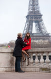 Romantic couple in Paris, near the Eiffel tower. Romantic couple in love in Paris, near the Eiffel tower, laughing Royalty Free Stock Images