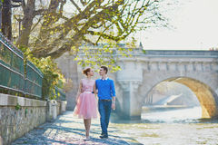 Romantic couple in Paris near the river Seine Royalty Free Stock Images