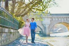 Romantic couple in Paris near the river Seine. Beautiful romantic couple in Paris near the river Seine, walking together Stock Photos