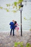 Romantic couple in Paris near the Seine Stock Photos