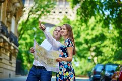 Romantic couple in Paris on a summer day Royalty Free Stock Images