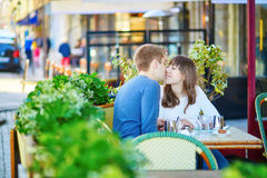 Romantic couple in a Parisian street cafe Stock Images