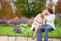 Romantic couple in a park. Romentic couple in a park, having a date stock images