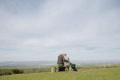 Romantic Couple On Park Bench Royalty Free Stock Photography