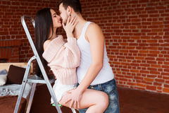 Romantic couple. Passion time. Young loving couple embracing and looking to each other at home. Royalty Free Stock Photography