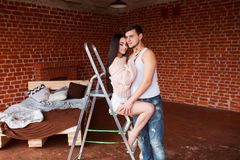 Romantic couple. Passion time. Young loving couple embracing and looking to each other at home. Stock Image