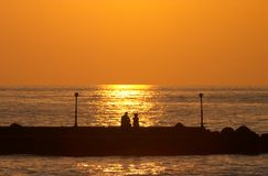 Romantic couple on a pier royalty free stock photography