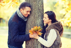Romantic couple playing in the autumn park Stock Image