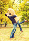 Romantic couple playing in the autumn park Stock Photography