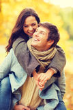 Romantic couple playing in the autumn park Royalty Free Stock Image