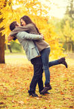 Romantic couple playing in the autumn park Stock Images