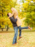 Romantic couple playing in the autumn park Stock Photo