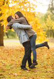 Romantic couple playing in the autumn park Stock Photos