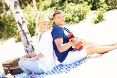 Romantic couple playing guitar at the beach Royalty Free Stock Image
