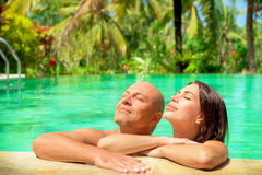 Romantic couple in a pool Stock Images