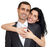 Romantic couple portrait, happy faces, dressed in black suit, isolated white Royalty Free Stock Photography