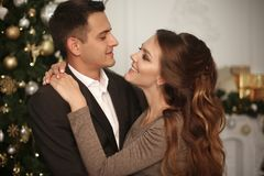 Romantic couple portrait in love. Cheerful Happy newlywed huggin stock photo
