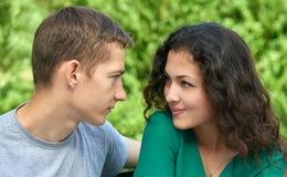 Romantic couple portrait posing in city park, summer season, lovers boy and girl Stock Photos