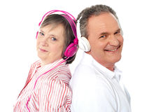 Romantic couple posing back to back. Listening to music Royalty Free Stock Image
