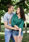 Romantic couple posing in city park, summer season, lovers boy and girl Royalty Free Stock Photos