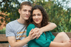 Romantic couple posing in city park, summer season, lovers boy and girl Royalty Free Stock Images