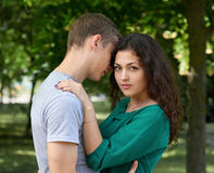 Romantic couple posing in city park, summer season, lovers boy and girl Royalty Free Stock Photo