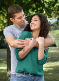Romantic couple posing in city park, summer season, lovers boy and girl Stock Images